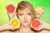 Portrait of woman with fruits — Stock Photo