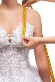Measuring the distance from shoulder to breast — Stock Photo