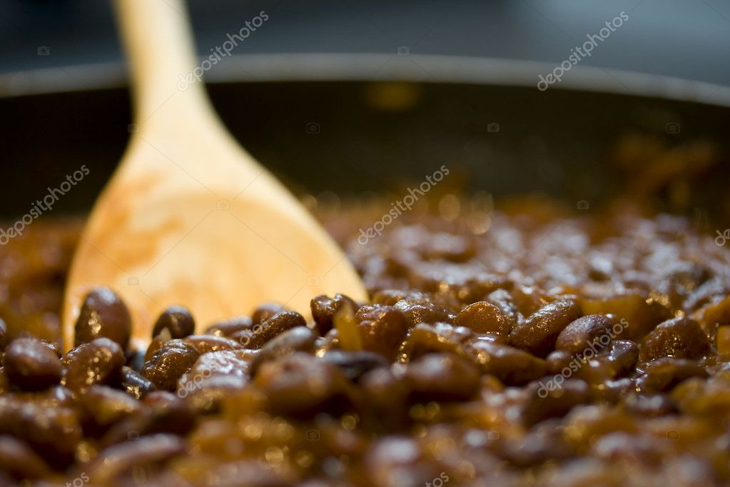 Spoon in beans  Stock Photo #5556055