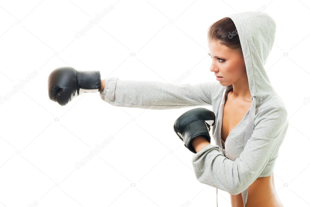 Conident strong woman hit the goal with right hand, boxing, profile view,isolated  Stock Photo #5556641