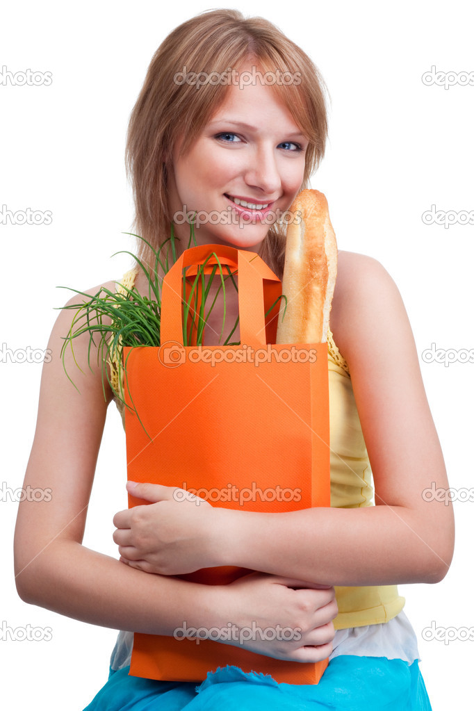 Pretty woman looking at camera holding bag — Stock Photo #5558067