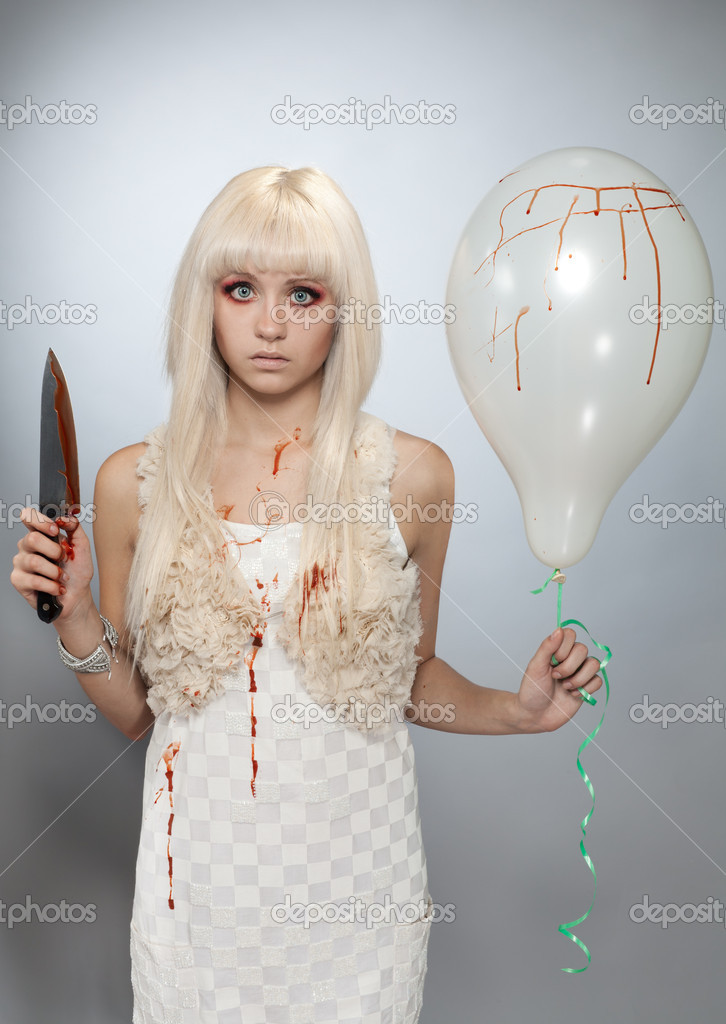 Young mad girl standing with balloon and knife in blood  Photo #5558669