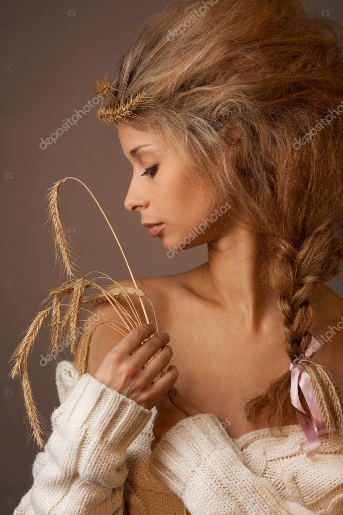 Beauty portrait of provincial woman with wheat with professional make up and hair style  Stock Photo #5559058