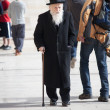 Royalty-Free Stock Photo: Old ortodox Jewish man with walking stick near the Western Wall