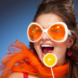 Woman with citrus lollipop — Stock Photo #5858572