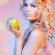 Curly blond woman with green apple — Stock Photo #5858593