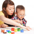 Stock Photo: Mother teaches