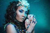 Underwater queen with treasures — Stock Photo