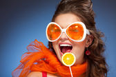 Woman with citrus lollipop — Stock Photo