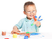 Chinese boy painting with hands — Stock Photo