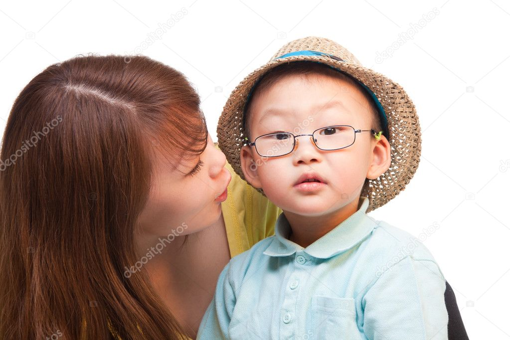 Chinese mother and kid in traveler hat, together, isolated on whtie  Stock Photo #5858622
