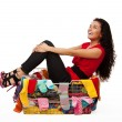 Happy woman in basket with clothes — Stock Photo #6288067