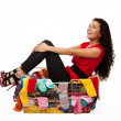 Stock Photo: Happy woman in basket with clothes