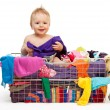 Happy baby with clothes - Stock Photo