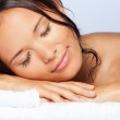 Girl sleeping on the towel — Stock Photo #6288245