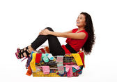 Happy woman in basket with clothes — Stock Photo