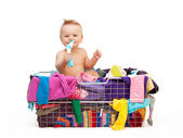 Toddler in basket with clothes — Stock Photo