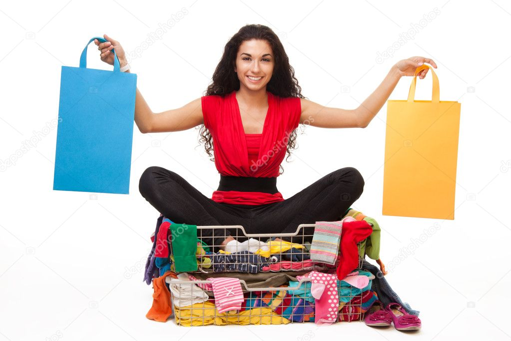 Young woman considering shopping options holding two bags — Stock Photo #6288053