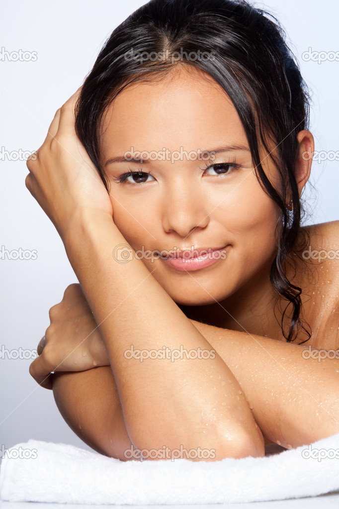 Portrait of happy confident Asian woman after shower showing positive expression leaning on towel  Stock Photo #6288253