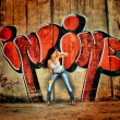 Girl on graffiti wall background — Stock Photo