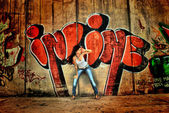 Girl on graffiti wall background — Foto de Stock