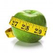 Green apple with measure tape — Stock Photo