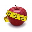 Red apple and measurement tape — Stock Photo