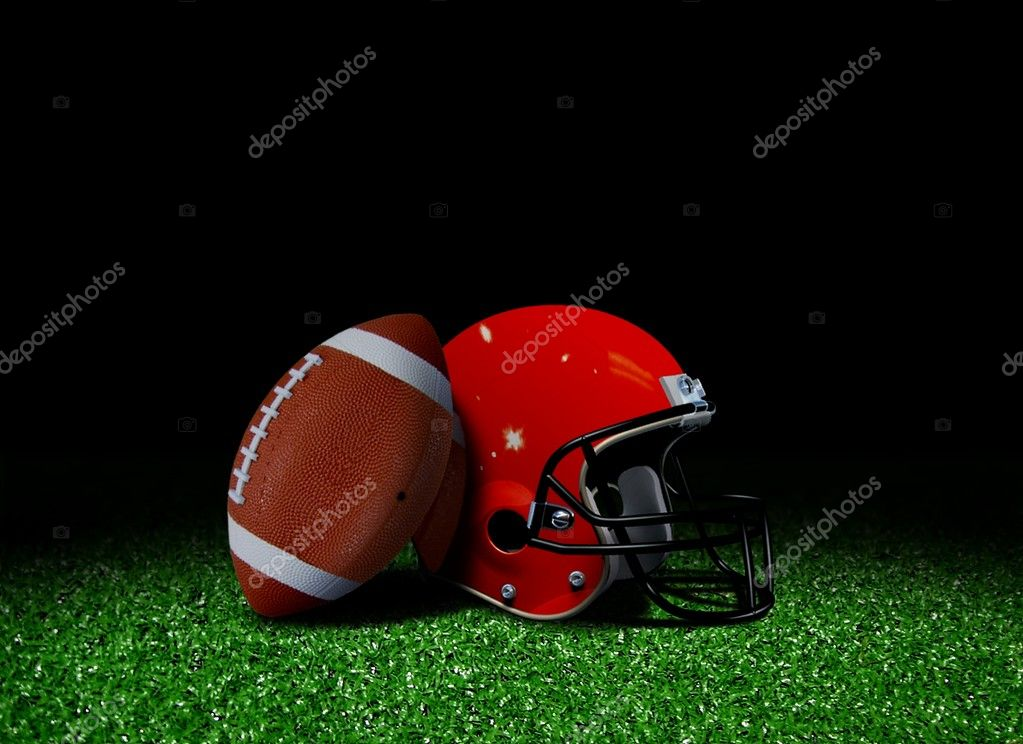 American football and helmet on field — Stock Photo #6414209
