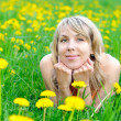 Blonde woman on the grass — Stock Photo