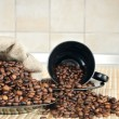 Coffee beans with a cup and sack — Stock Photo