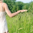 Woman touching grass — Stock Photo