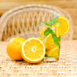 Glass of limonade with oranges — Stock Photo