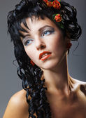 Glamour woman with modern curly hairstyle and brightly makeup — Stockfoto