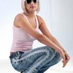 Blonde woman wearing sunglasses — Stock Photo