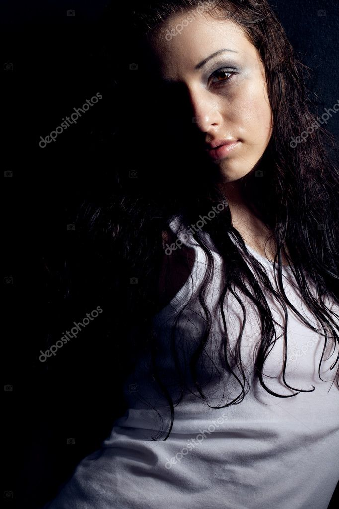 Beautiful wet sexy woman portrait near black wall — Stock Photo #5587808