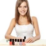 Beautiful woman choosing nail polish — Stock Photo