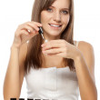 Stock Photo: Beautiful woman choosing nail polish