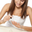 Beautiful woman polishing nails - ストック写真