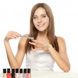 Beautiful woman holding nail file - ストック写真
