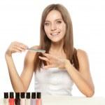 Beautiful woman holding nail file — Stock Photo