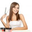 Beautiful woman holding nail file - Stock Photo