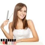 Beautiful woman holding nail file — Stock Photo #5655455