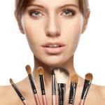 Beautiful woman holding makeup brushes set — Stock Photo #5655507