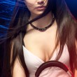 Beautiful woman dj wearing headphones - Stok fotoraf