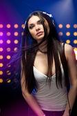 Beautiful woman dj wearing headphones — Stock Photo