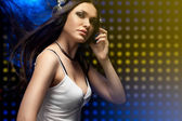Beautiful woman dj wearing headphones — Stock Photo