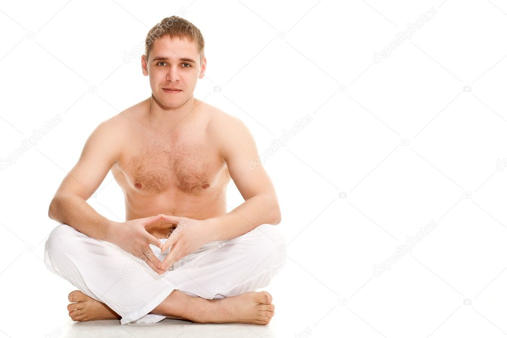 Man wearing white pants sitting on the floor  Stock Photo #5953423