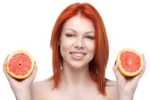 Red woman holding grapefruit — Stock Photo