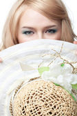 Blond woman looking behind hat — Stock Photo