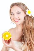 Beautiful woman holding orange — Stock Photo
